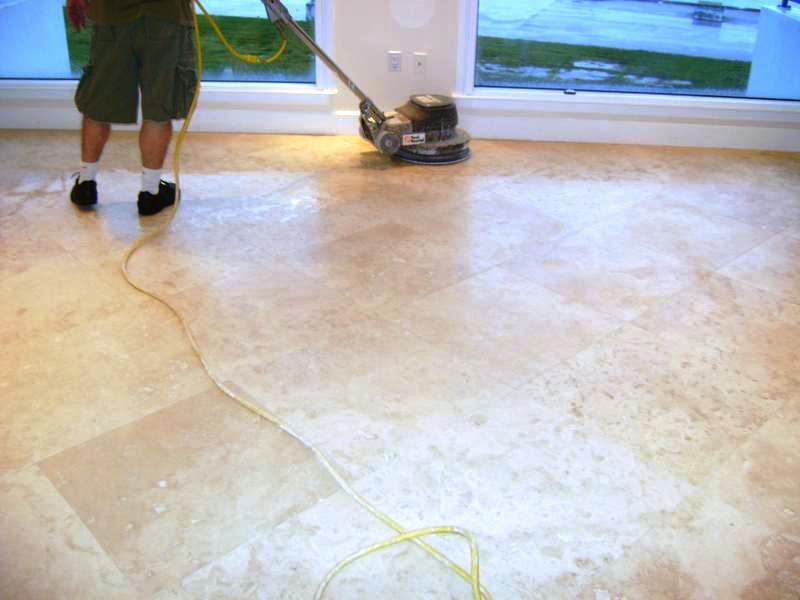 Removing tile from terrazzo floor