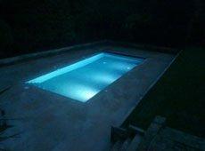 Outdoor pool illuminated at night