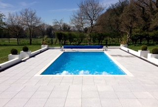 Outdoor pool with paving surround