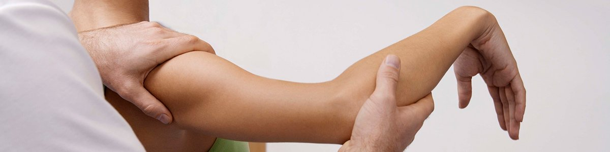 Osteopathic treatment on the arm in New Town