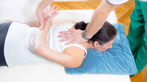 Doctor providing chiropractic services to a patient in Kingman, AZ