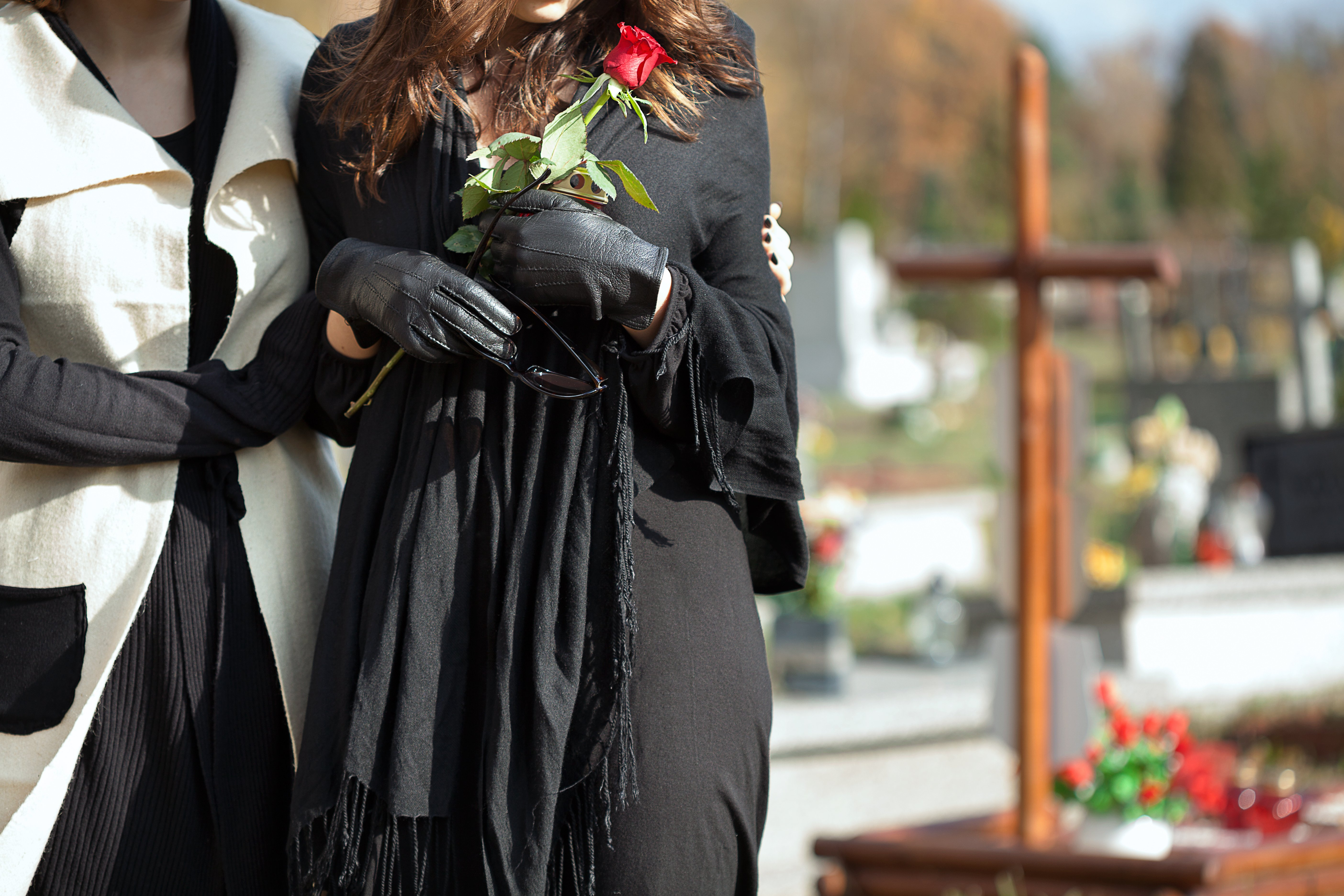 A pair of women at a funeral