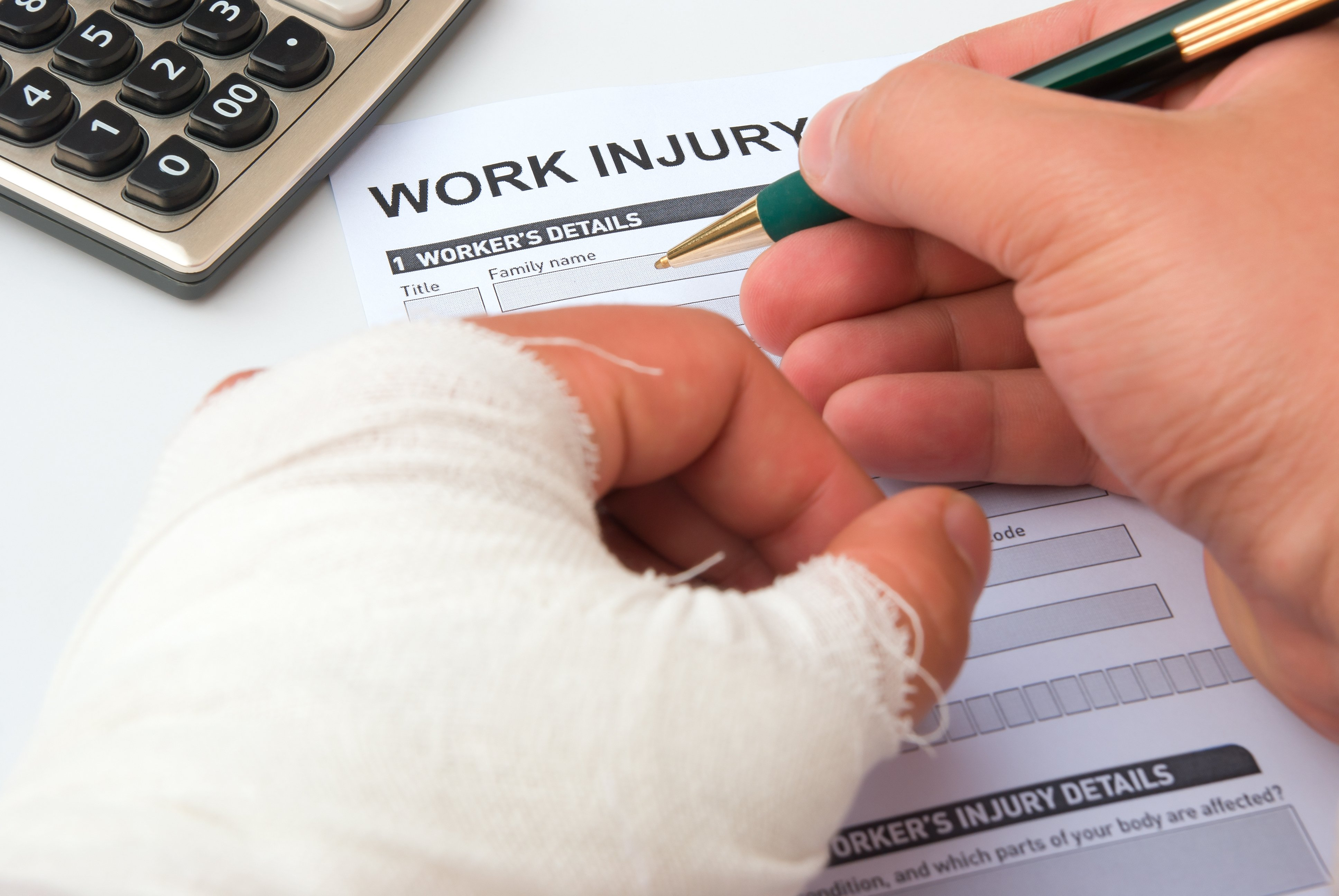 An injured worker fills out an injury form