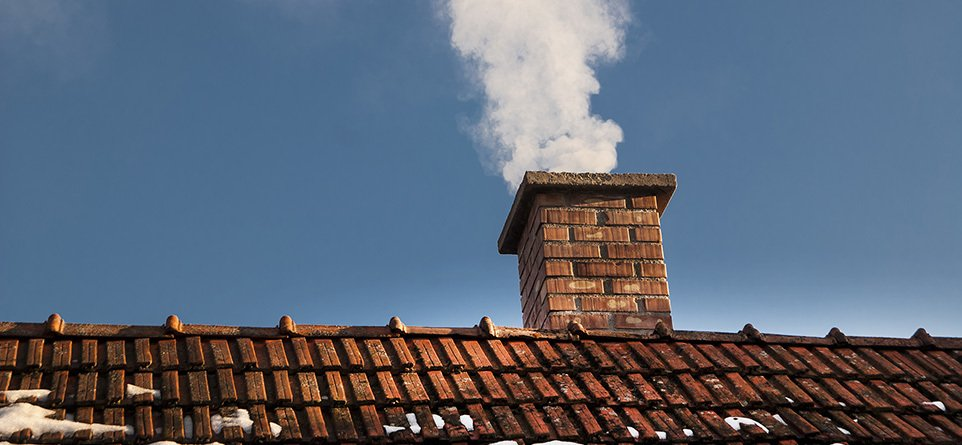 A chimney with smoke coming from it
