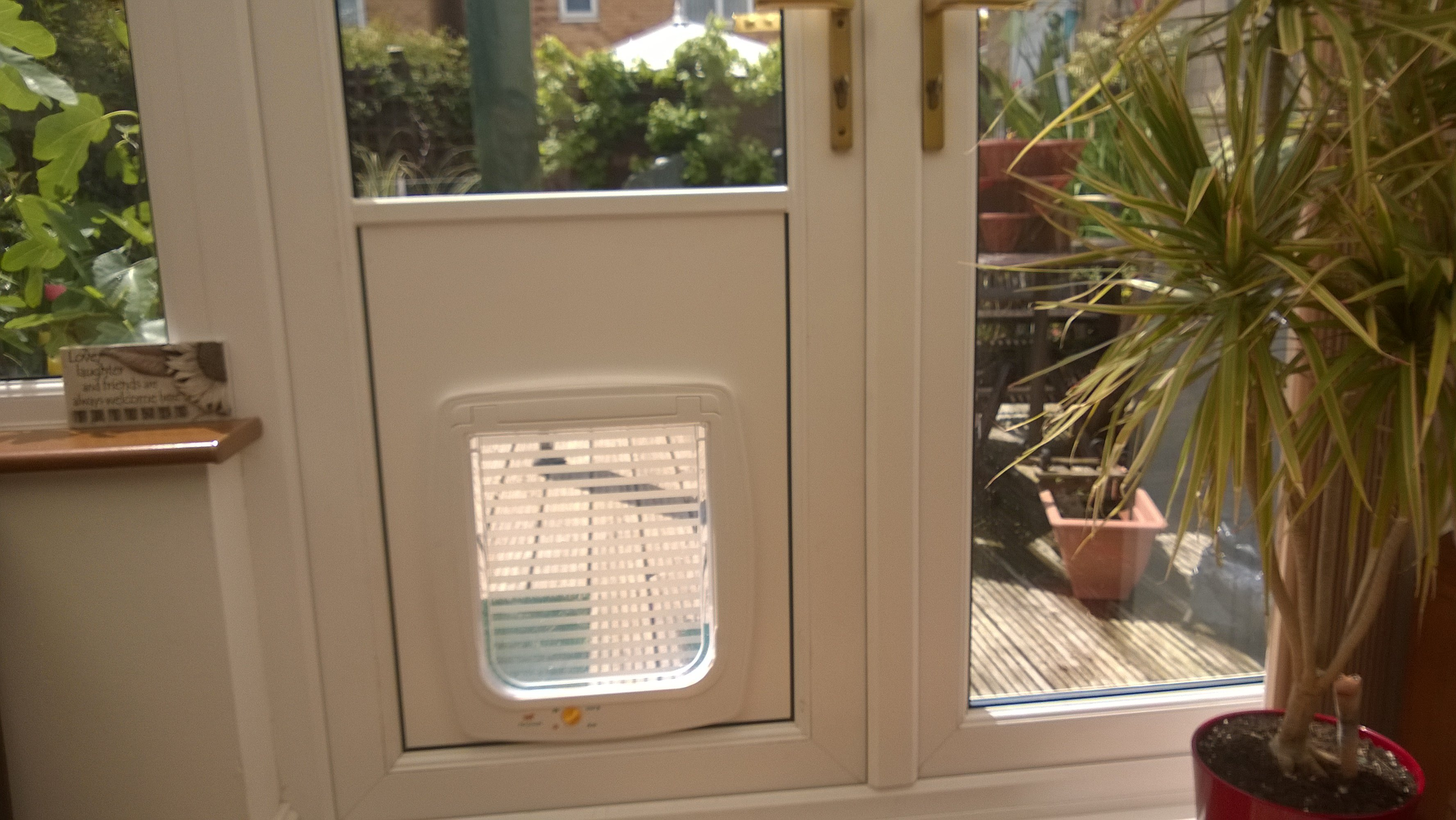 Cat flaps coventry dog flaps cat flap installers dog for Upvc french doors with cat flap