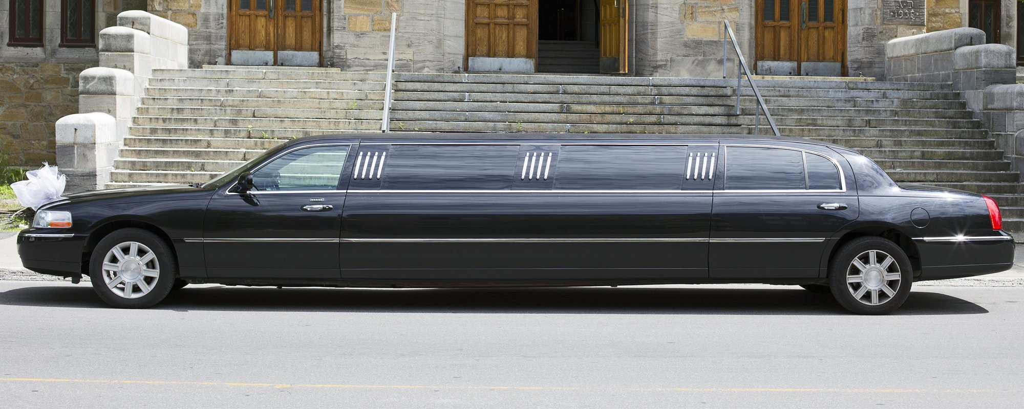 Black Limo parked in fronty of the stairs