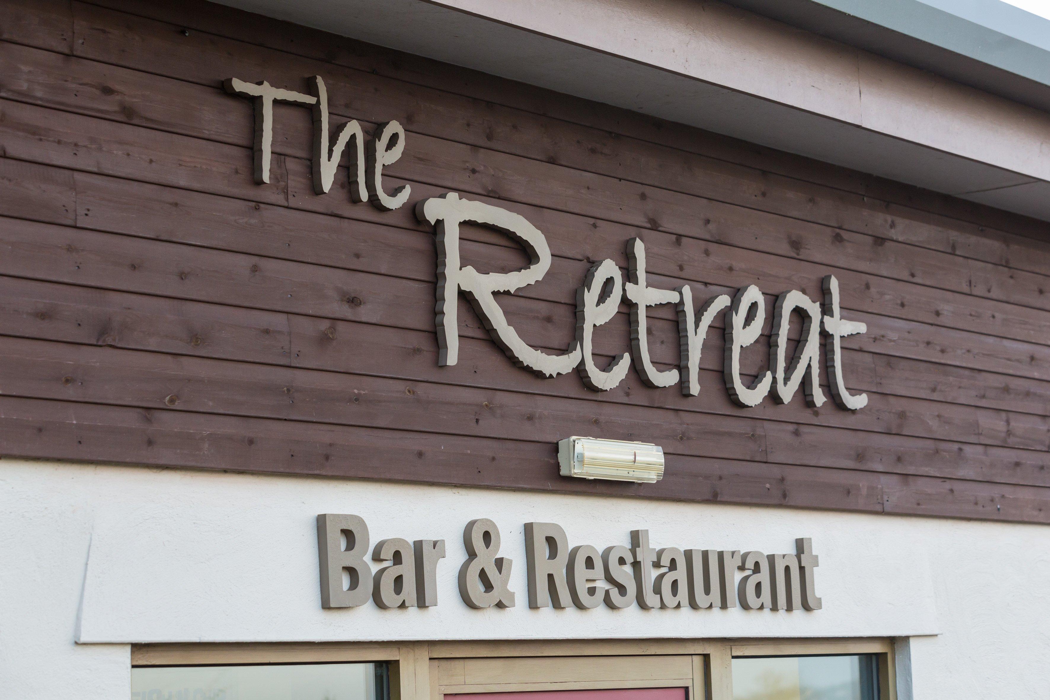 The Retreat name board