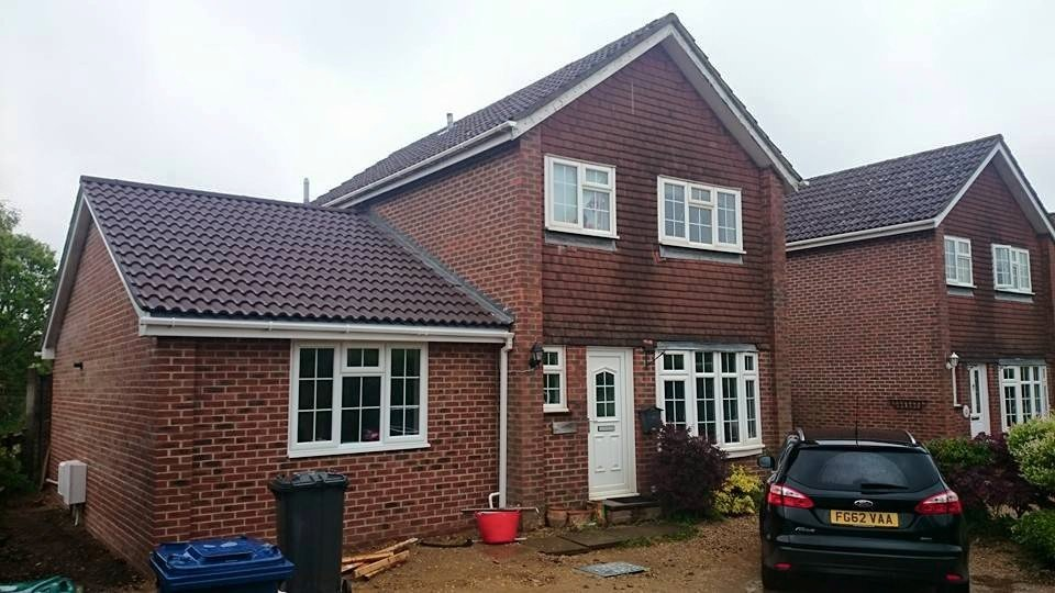 Complered home extension on a house with white uPVC windows and door