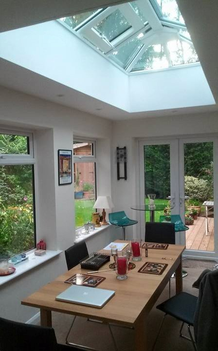 Dining furniture inside a home extension with patio doors