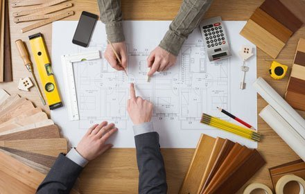 Aerial view of architects working on a building plan