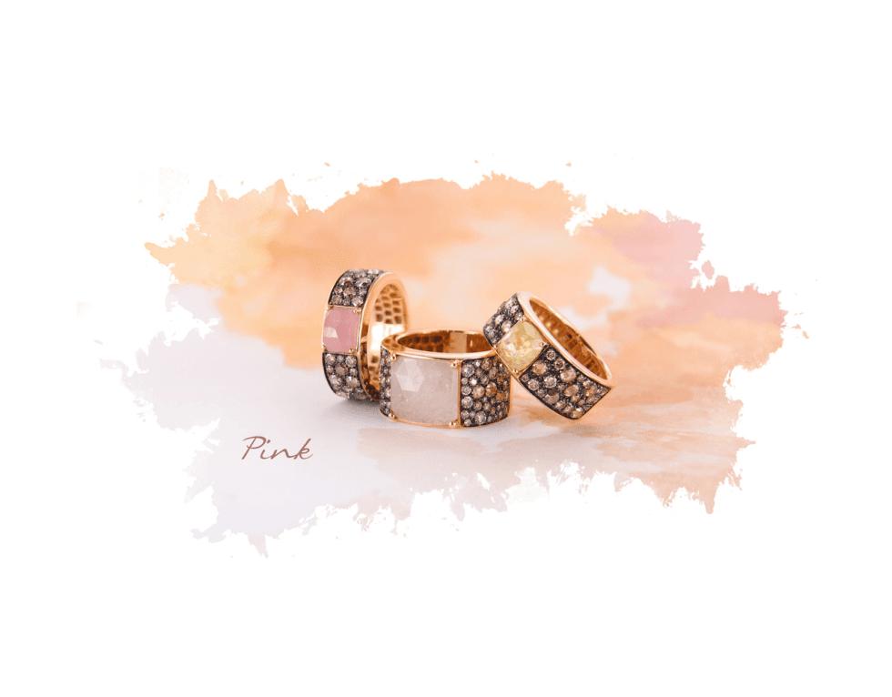 due anelli rosa con zirconi e pietre