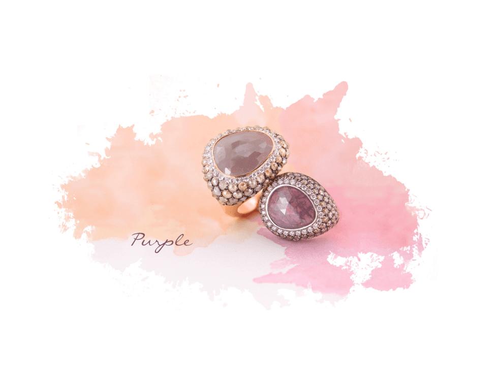 due anelli viola con zirconi e pietre