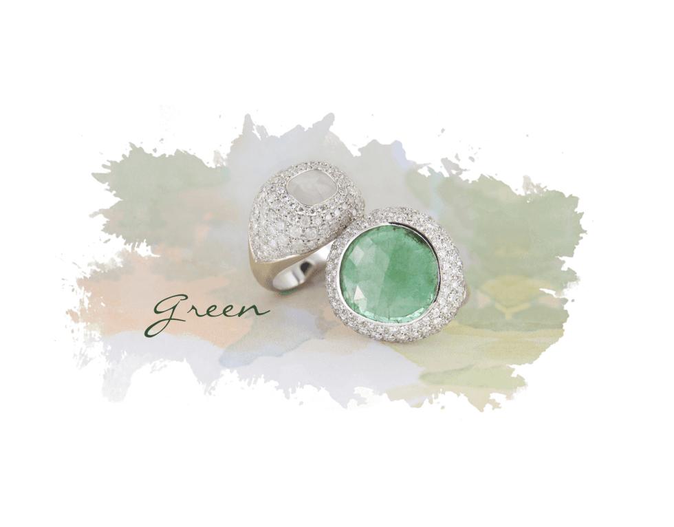 due anelli verdi con zirconi e pietre
