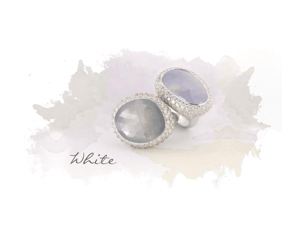due anelli bianchi con zirconi e pietre