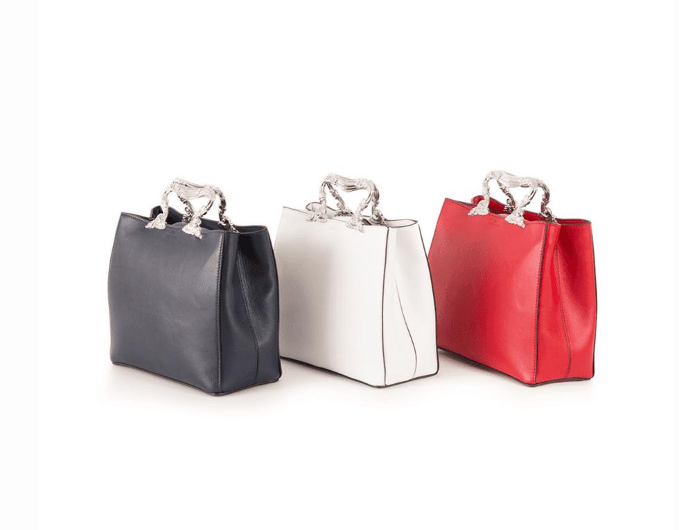 tre borse di pelle colorate