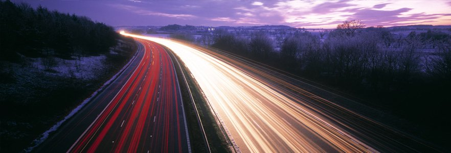 long exposure of traffic at night showing tail and headlights
