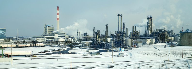 refinery landscape with towers and white foreground