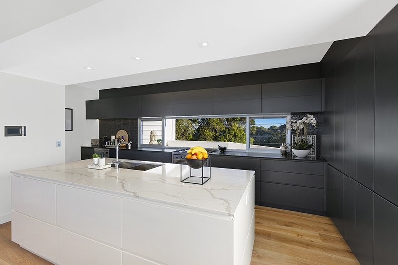 contemporary kitchen with grey wall and marble