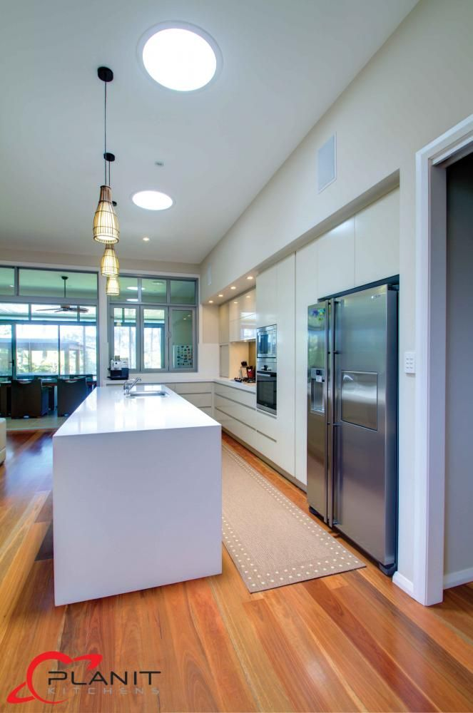 contemporary kitchen with island and downlights