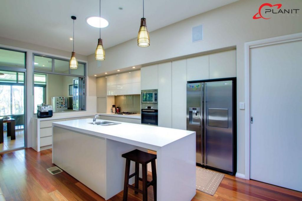 contemporary kitchen with island and small built in breakfast bar