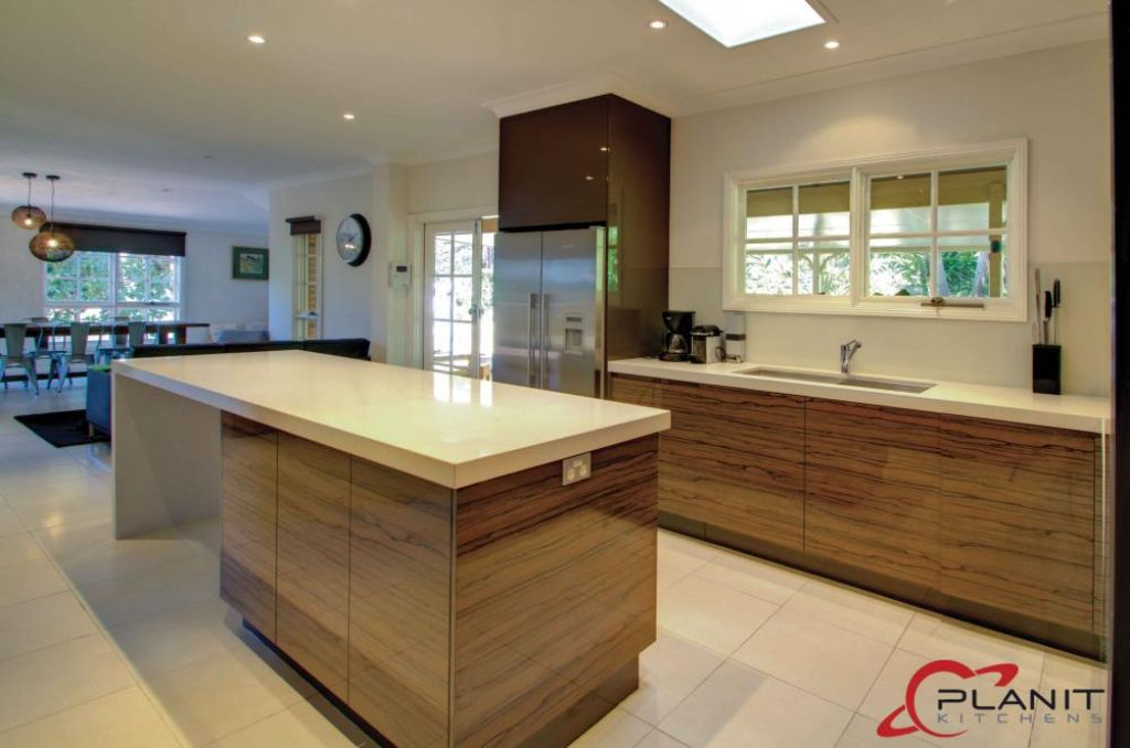 contemporary wood panelled kitchen with island