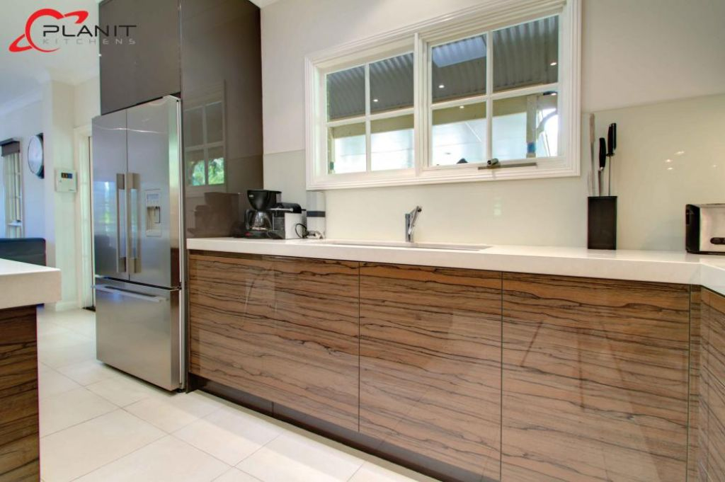 contemporary wood panelled kitchen
