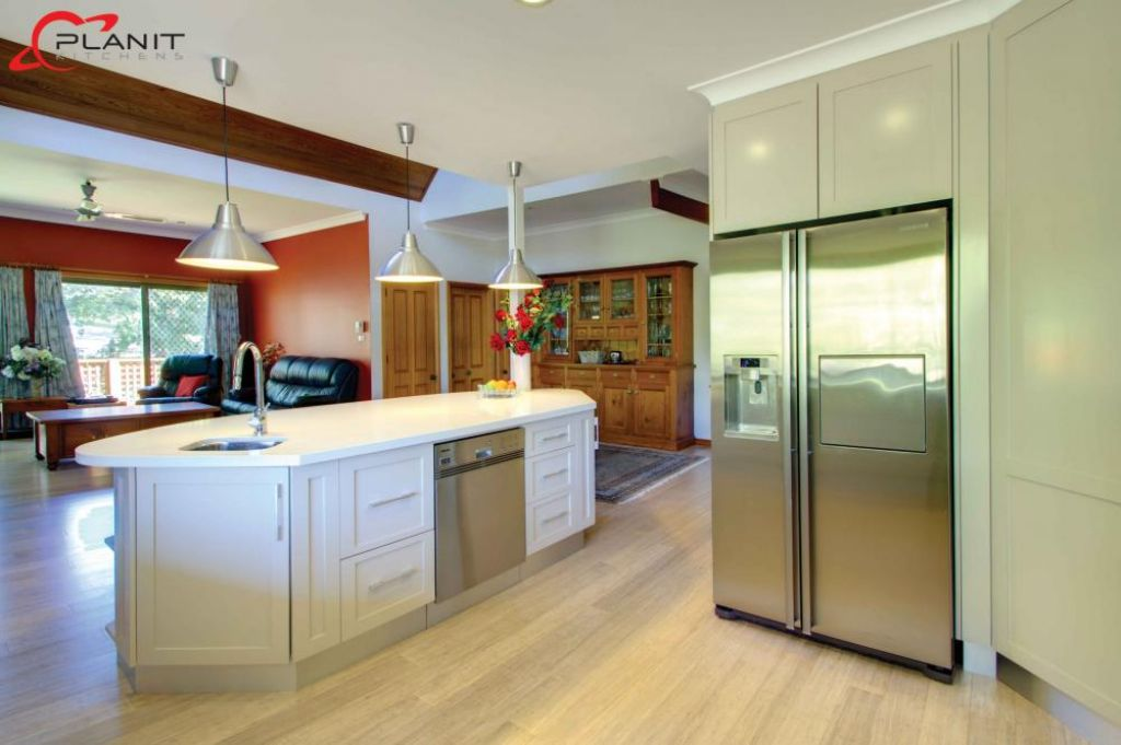 elegant kitchen with large down lights
