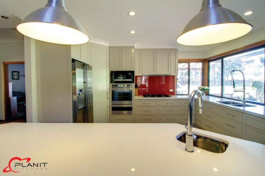 elegant kitchen with large feature down lights