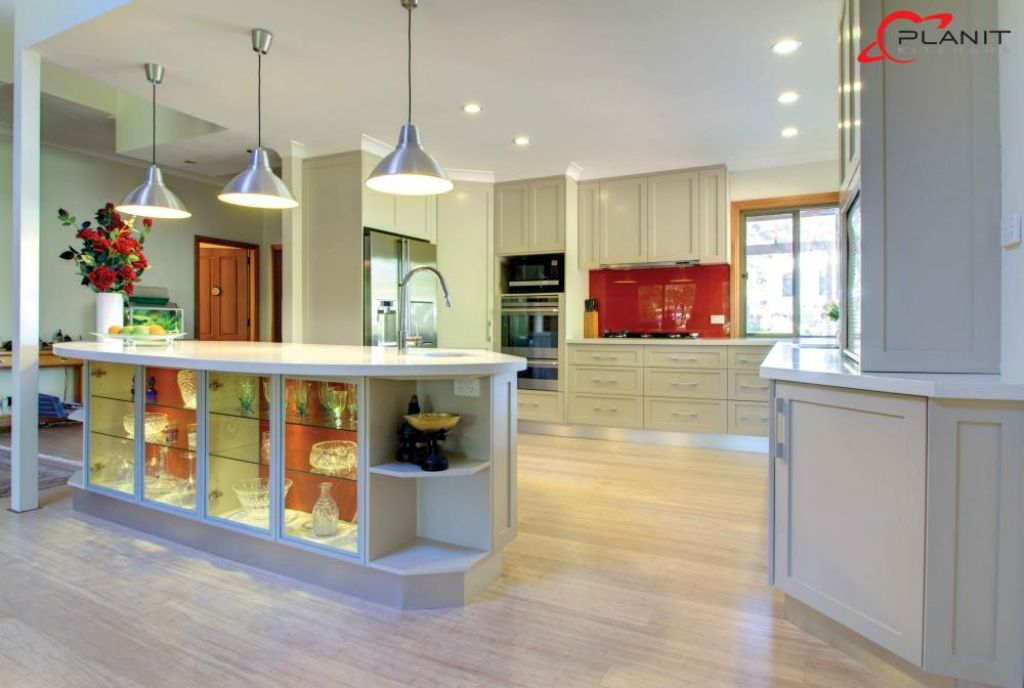 elegant kitchen with down lights and built in china cabinet