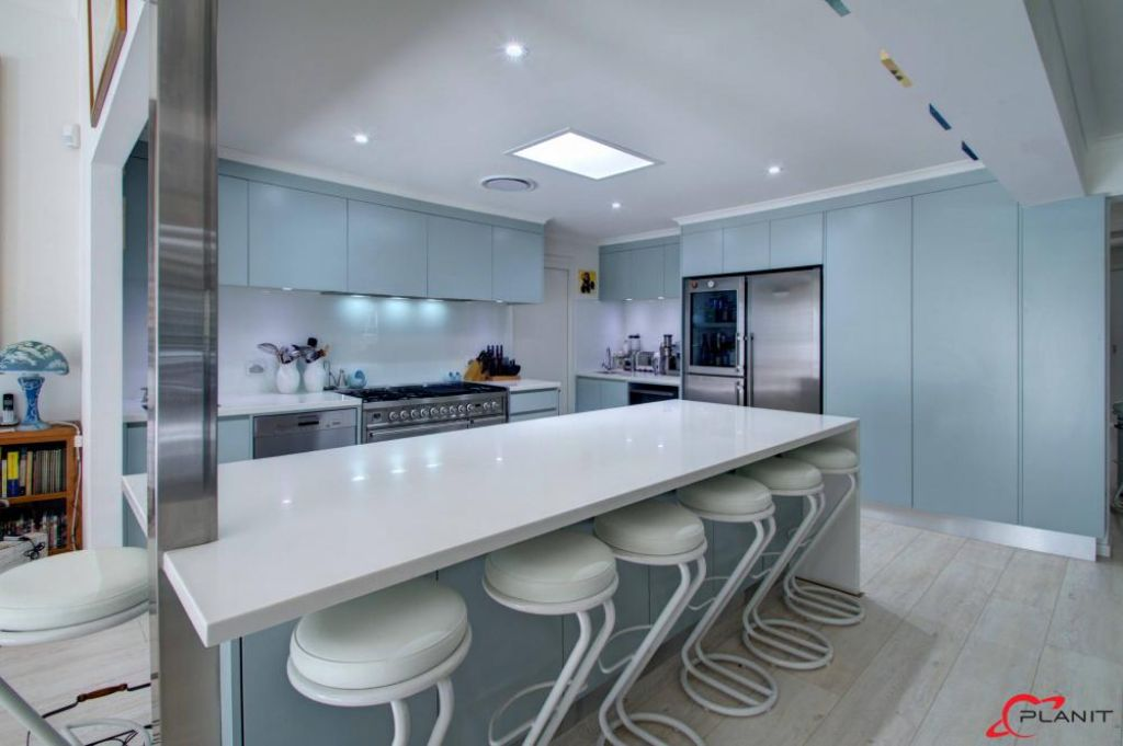 contemporary kitchen with large breakfast bar