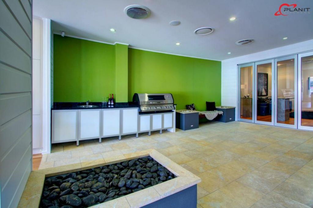 contemporary outdoor area with lime green feature wall