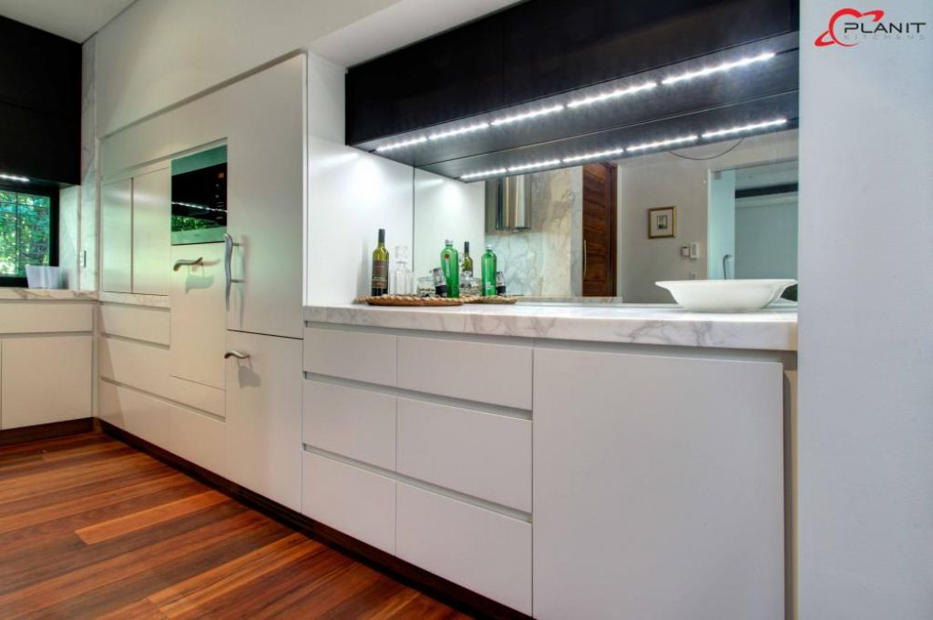 elegant marble featured kitchen with bar