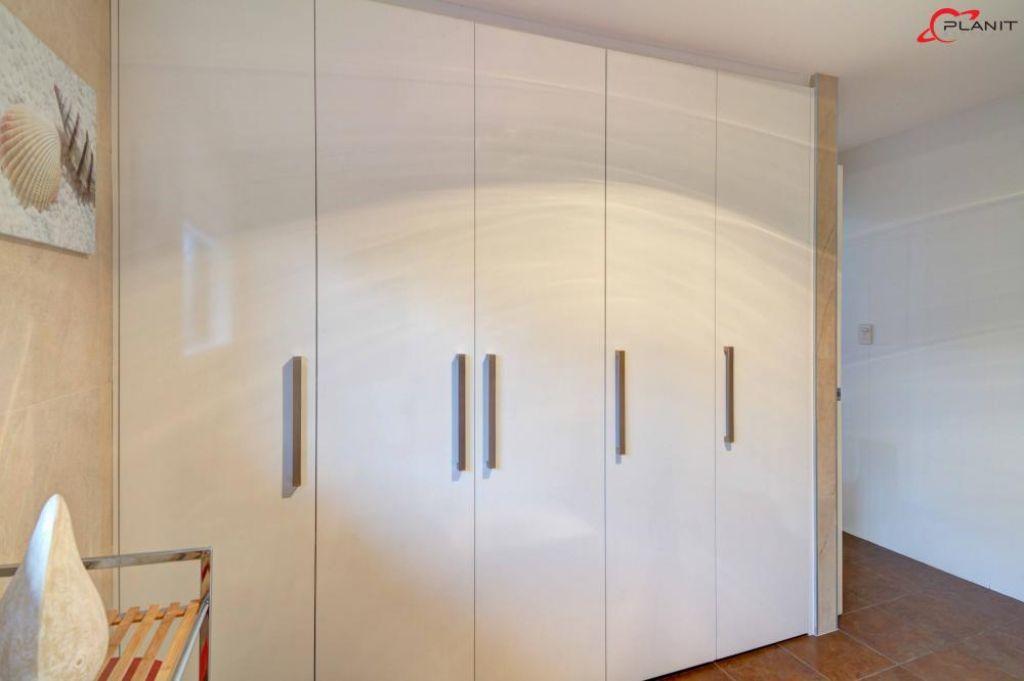 classic laundry hidden by cupboard doors