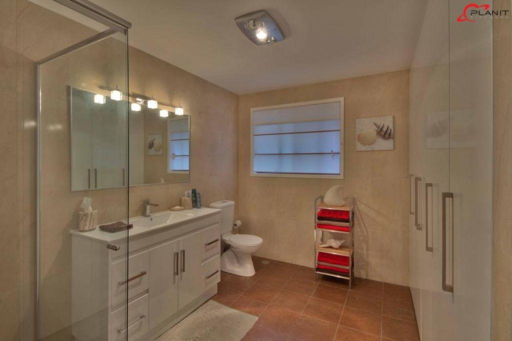 classic bathroom and hidden laundry