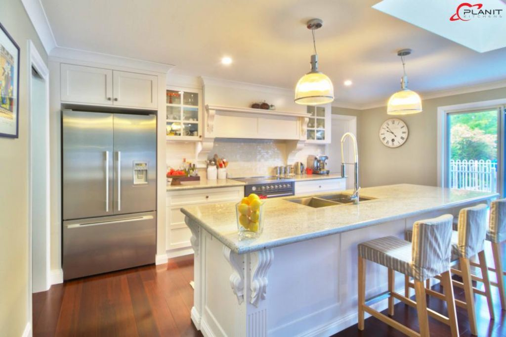 traditional kitchen with island and beautiful finishings