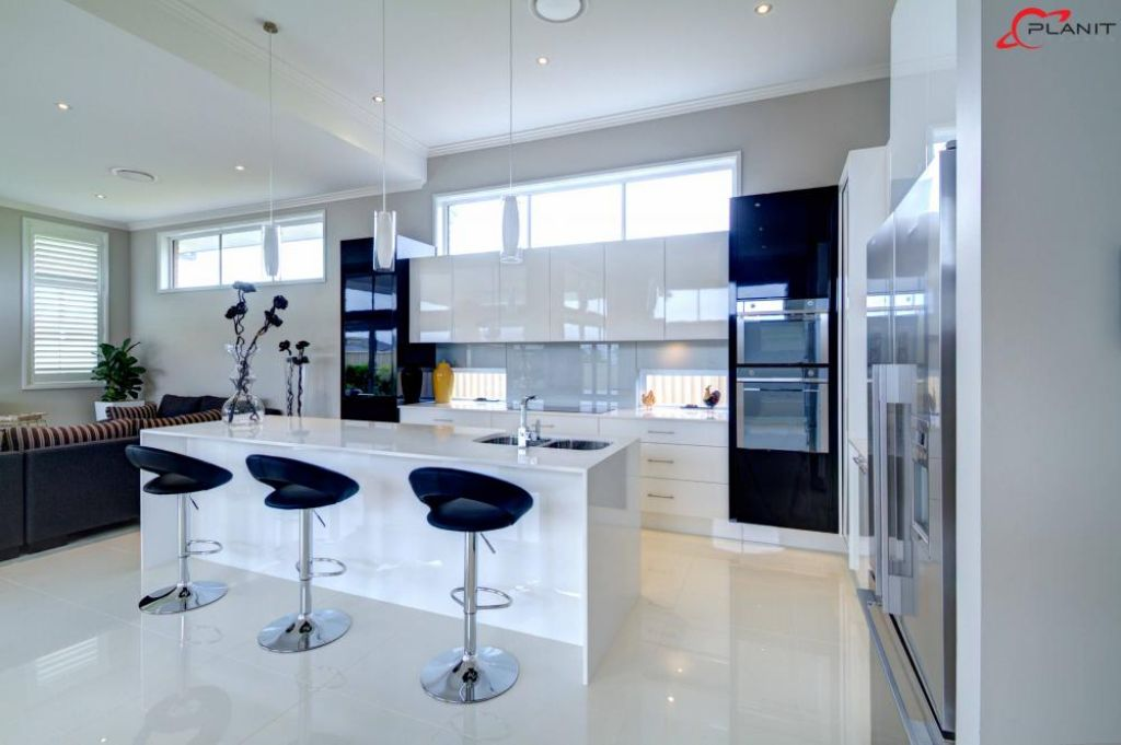 elegant black and white kitchen with breakfast bar