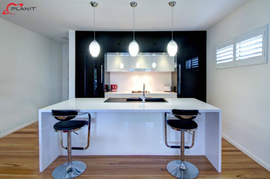 elegant black and white kitchen with feature down lights