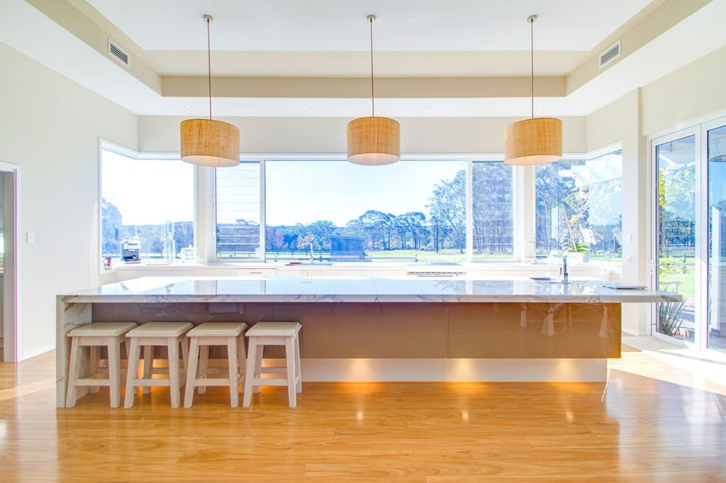 contemporary open kitchen facing countryside with down lights