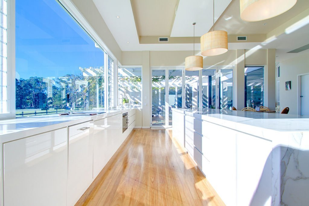 contemporary open kitchen with large windows