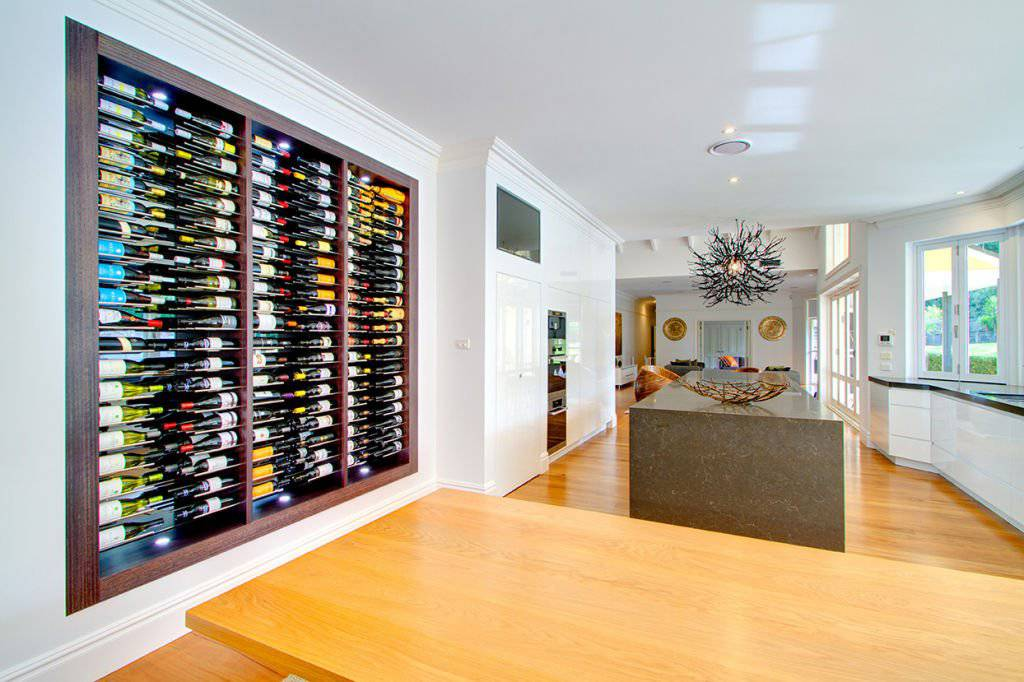elegant kitchen with built in wine shelf feature