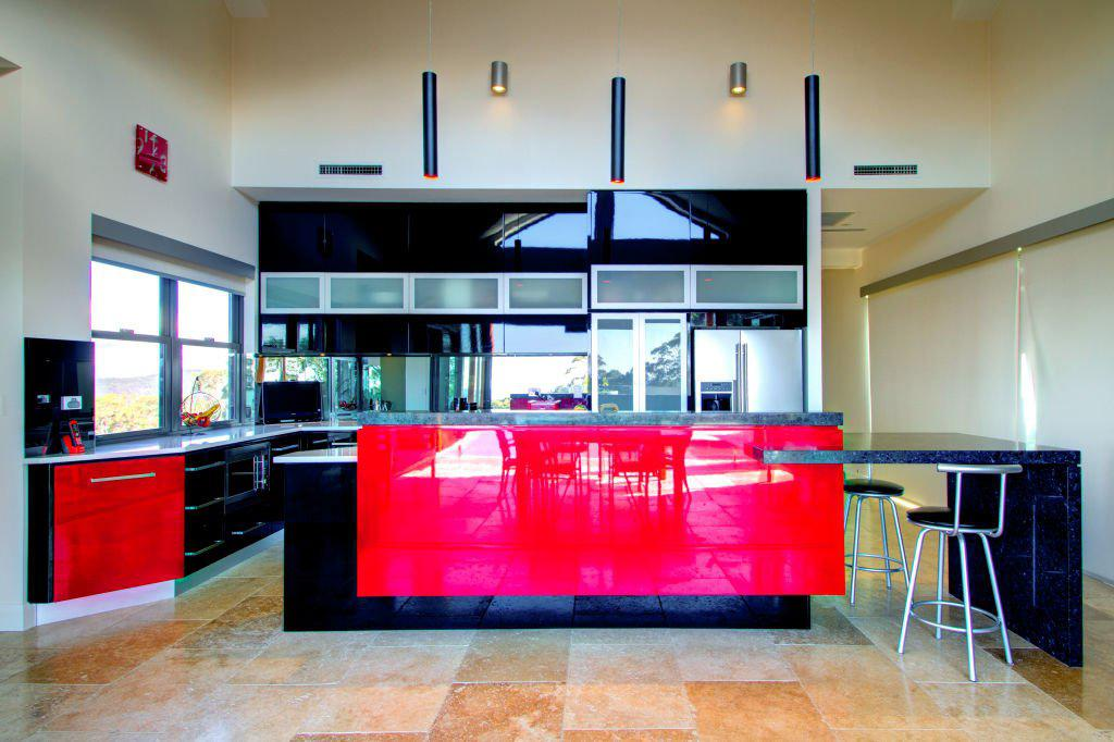 contemporary bright red black and white kitchen with breakfast bar