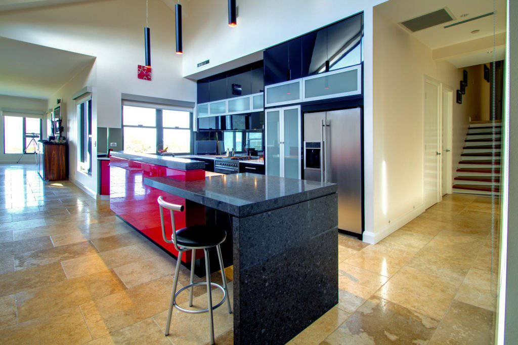 contemporary bright red black and white kitchen with island and breakfast bar