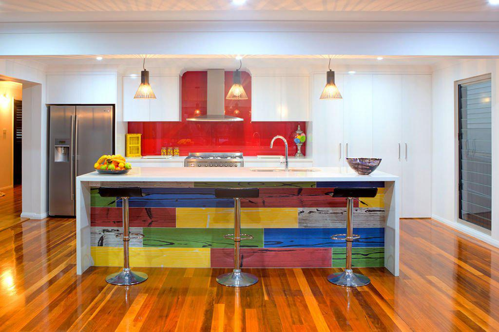 contemporary kitchen with red splash back feature