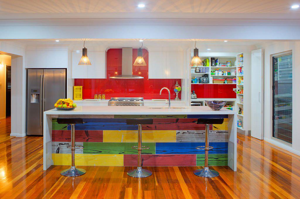 contemporary kitchen with multicolour feature island and down lights