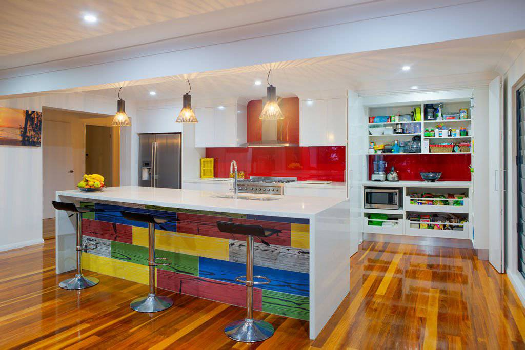 contemporary kitchen with multicolour feature island and downlights