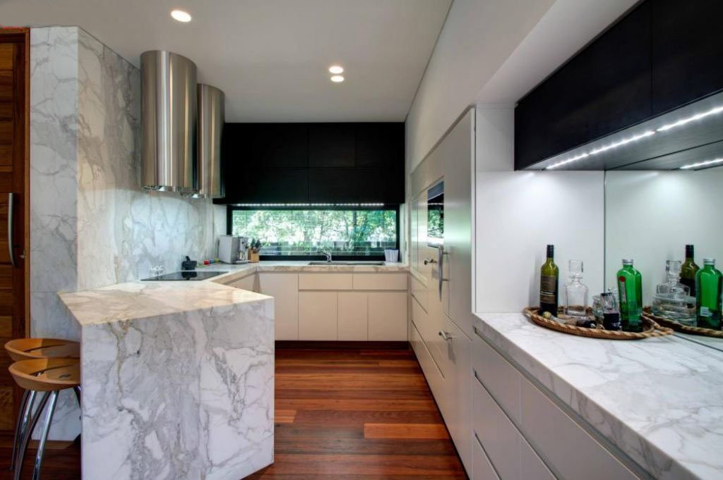 marble featured kitchen with breakfast bar