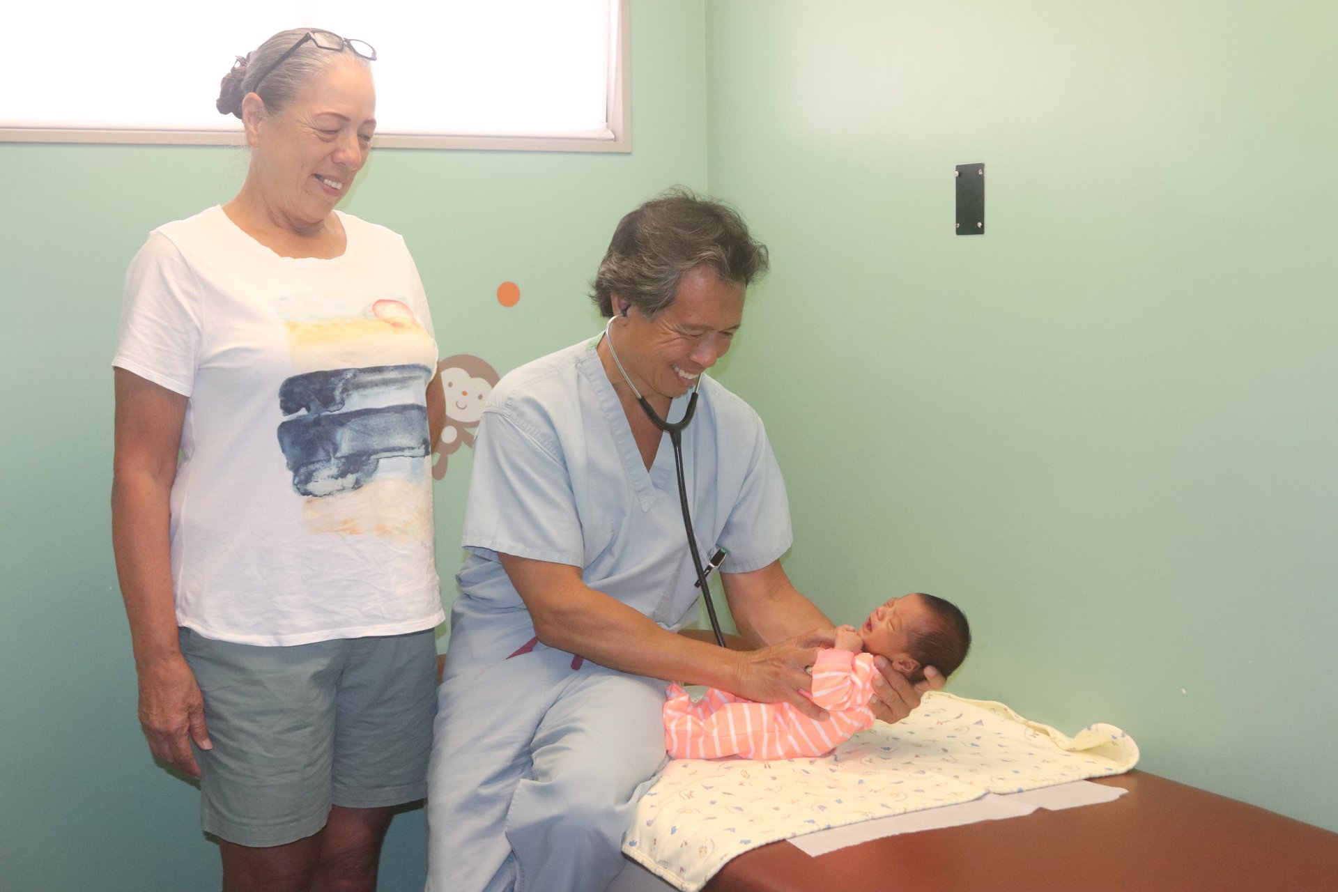 Child and mother with doctor at hospital, Kaneohe, HI