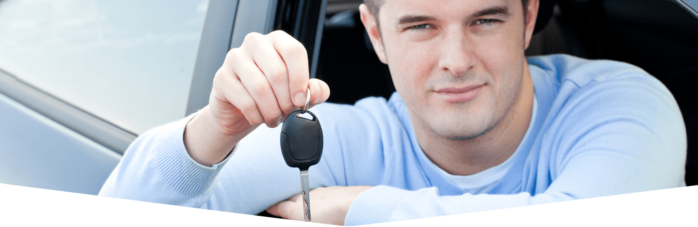 Young individual showing the automobile key