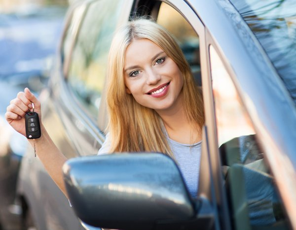 Young confident professional after driving lessons