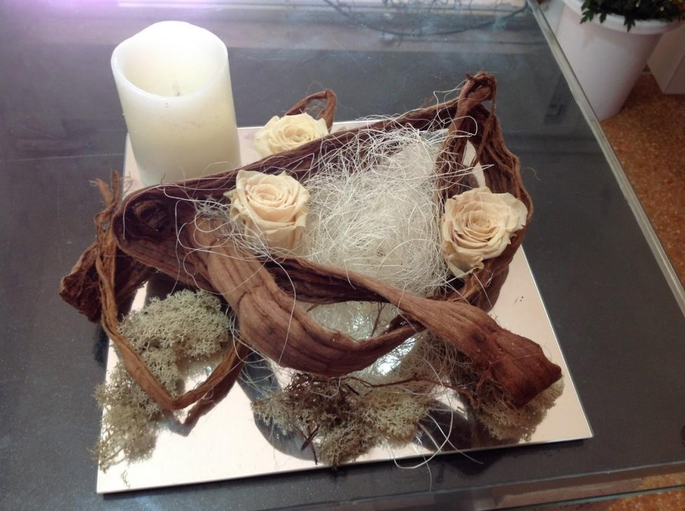 Composizioni di fiori secchi e candele